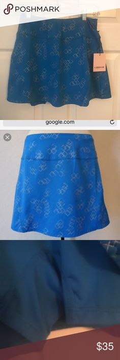 "NWT Chrissie By Tail Tennis Skirt Pretty atomic blue with silver foil diamonds print. 13.5"" A-line flounce skirt. Inner brief with ball pockets on each leg. So cute and flattering! Chrissie By Tail Skirts"