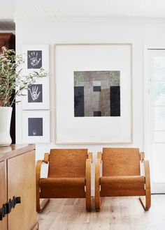 modern chairs pair with a gallery wall | relaxed ranch house tour on coco kelley