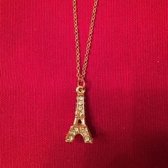 """Eiffel Tower Necklace Gold tone Eifel Tower necklace. Brand new never worn. Tower has rhinestones on it. This was a souvenir Bought in Paris but made in China! Lol! Chain is 16"""" long and nickel free. Tower is 1"""" tall. Jewelry Necklaces"""