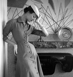 Ivy Nicholson in a princess-line dress of tobacco jersey by Jacques Fath, photo by Georges Dambier, Nouveau Femina, March 1954
