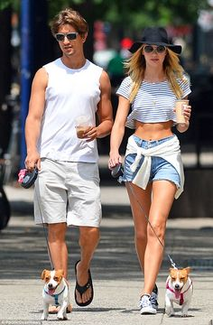 Lucky guy! Candice Swanepoel flashed her taut tummy as she and her boyfriend Hermann Nicol...
