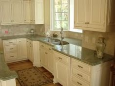 Fantastic White Kitchen Cabinets Green Granite Countertops Fantastic This Kitchen Features Coast Gre. Green Kitchen Countertops, Cream Kitchen Cabinets, Kitchen Paint, Kitchen Redo, Kitchen Flooring, Kitchen Ideas, White Cabinets, Cement Countertops, Colored Cabinets