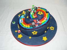 Rainbow road cake idea with Koopa Trooper and Mario figures