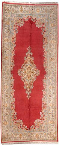 Kerman long carpet  South Central Persia  circa 1930  size approximately 5ft. 10in. x 13ft. 10in.