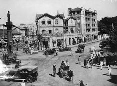 """""""Cars compete with horse-drawn carriages in a Bombay intersection in 1929."""""""