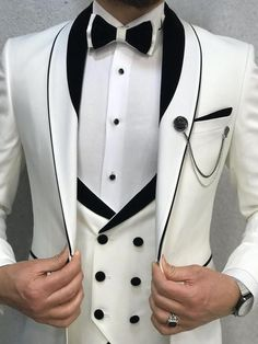 Name: Aalvert White Slim Fit Tuxedo Collection: Spring – Summer 2019 Product: Slim-Fit Tuxedo Color Code: White Size: Suit Material: Viscose, Poly Machine Washable: No Fitting: Slim-fit Package Include: Coat, Vest, Pants and Bow Tie Slim Fit Tuxedo, Tuxedo Suit, Tuxedo For Men, Groom Tuxedo, Tuxedo Jacket, Wedding Dress Men, Wedding Men, Men's Wedding Wear, Best Wedding Suits For Men
