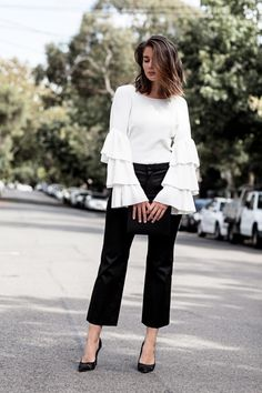 How to Dress Like Fashion Blogger Sara Donaldson—55 Outfit Ideas to Steal | White flared sleeve top styled with cropped black trousers and classic heels | @stylecaster