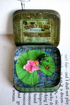 Frog on lily pad tin ..