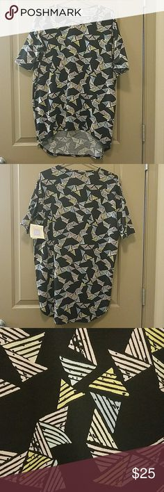 New LuLaRoe High Low Tunic Top Brand new with tags LuLaRoe top. High low style with the back being longer in the front. Retro print pattern in blue, pink and yellow, with black background. This brand runs big, so you can size down. I wear small and medium tops, but I have XXS tops in this brand that fit loose. Everything Lu La Roe makes is very comfortable. LuLaRoe Tops Tunics