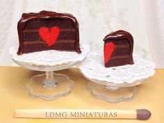1:12 Scale. Surprise Heart Chocolate Cake with Slice. Dollhouse Miniature Food by LDMGMiniatures on Etsy https://www.etsy.com/listing/222551282/112-scale-surprise-heart-chocolate-cake