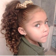 Gorgeous little girl with amazing green eyes and long curly hair