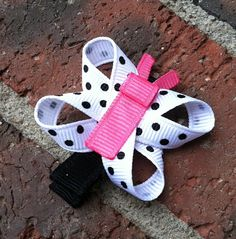 Hot Pink, Black, and White Polka Dotted Butterfly Ribbon Sculpture Hair Clip... Free Shipping Promo. $3.50, via Etsy.