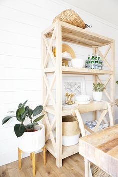 Dining room shelving is so perfect for storage and adding interest! A Simple Spring Home Tour Entry Furniture, Dining Room Furniture, Dining Chairs, Wood And Metal, Metal Walls, Coffee Table Rug, Dining Room Storage, Patterned Chair, Spring Home