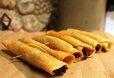 """The name of these crispy rolled tacos (""""Flautas"""") is given to them because of…"""