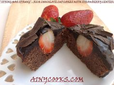 RICH CHOCOLATE CUPCAKES WITH STRAWBERRY CENTERS....