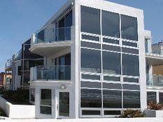 Luxury 2nd floor condo- 3 patios, views, full kitchen, near beach 4 bedrooms