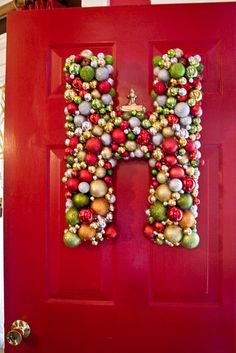 easy DIY front door hanger. ornaments attached to a cardboard box letter. cute for Christmas or could do for any season!