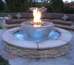 Double duty - a water feature and firepit all rolled into one.  I need this in my backyard!