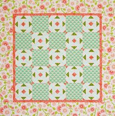 For a fresh take on the classic Endless Squares block, use whimsical floral fabrics in pink and mint, and frame the quilt center with a large-scale floral.