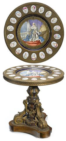 A Louis XVI style gilt bronze and porcelain mounted mahogany center table late 19th century
