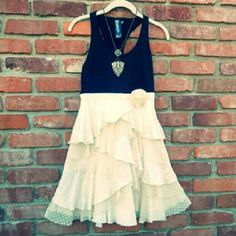 Ruffled Razor Back Tank Dress An adorable dress from Forever 21! The top is stretchy black cotton similar to a nice weight razor back T. Skirt is made up of gentle ruffles both front & back.  Side zip with poly lined skirt. Waist:  14.5 inches.  Length:  33.5 inches.  Underarm to underarm:  16 inches. Forever 21 Dresses