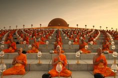 Monks pray while promoting world peace at the Wat Phra Dhammakaya temple in Thailand.
