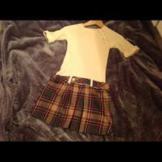 Girls dress size 9-10 plaid skirt Worn once by my 9 year old for Xmas dinner as you can see by the excellent condition it is in. It reminds me of a 60's style dress, the belt fits low at the waist and she wore this with black leggings and boots. I still love it but not her. Dresses Mini