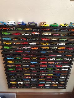 Creating a super cool shelf to corral all those Hot Wheel cars-made from wooden shoe racks from Bed, Bath and Beyond:  http://www.aloandbeholdlife.com/2014/01/diy-matchbox-car-garage.html