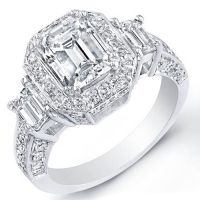 Make that unconditional promise when you propose to her with this gorgeous 5.42 Ct. diamond engagement ring. At its center is an impressive EGL certified 3.54 Ct. Emerald cut diamond with J color grade and very clean VS2 clarity. Additional 0.70 Ct. Emerald cut diamonds hug each side of the center stone while 1.18 Ct. Round cut diamonds surround it and adorn the shank. These side diamonds match the center diamond with I-J color grade and VS1-VS2 clarity. This diamond ring is available in 14K…