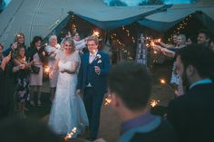 Sparkler Walkway. Tipi at night - Sami Tipi Leicestershire wedding - captured by Jonathan Flint Photography