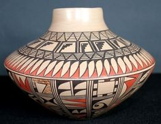 Silas has populated this jar with a concentration of both geometric and curvilinear designs.  Infrequently she has filled shapes with stippled slip.  The jar's tan neck gracefully compliments the shape of this vessel. $450
