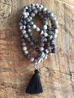 A personal favorite from my Etsy shop https://www.etsy.com/listing/560360410/beautiful-silk-stone-mala-108-mala-beads