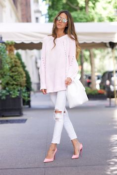 Pink maxi pullover. Distressed white skinny jeans. Pink heels.