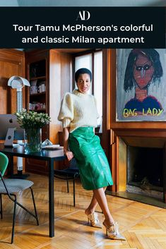 Style guru Tamu McPherson's home in Milan is an incredible mixture of original details, modern additions, and bold contemporary art. See how she brings her flair for fashion into her apartment. #wood #flooring #original #parquet #fireplace #artwork #mantle #mantel #office #shelving #bookshelves #fashionista #influencer #shoes #mule #skirt #sweater #portrait #painting #fireplace