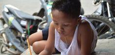 Hausaufgaben auf den Philippinen: Was wurde aus dem fleißigen Jungen vor McDonald's? - SPIEGEL ONLINE - Nachrichten - SchulSPIEGEL