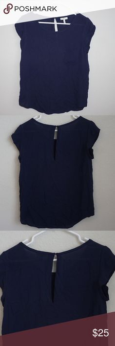 "🆕 Joie Navy Blue Silk Top Joie Navy Blue Silk Top  Color: Navy Blue  Size: Extra Small Condition: Excellent Material: 100% Silk  Measurements: Length 23""✖️Underarm to  Underarm 16"" Features: Keyhole opening in the button with button closure at neckline✖️ Front pocket Joie Tops Blouses"