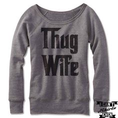 "Off the shoulder wide neck sweatshirt with ""Thug Wife "" print. Feminine, cozy and versatile, this sweatshirt is designed with an exceptionally plush fabrication, in a classic pullover fit with a wide"