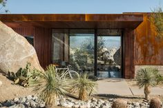 Cantilevered roof extends from Palm Springs guardhouse by Studio AR D