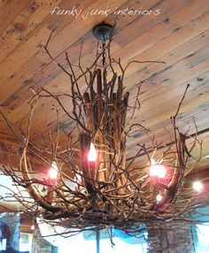 Make a white twig chandelier easily with grape vines and willow branches! You'll never believe there was a thrift store chandelier underneath.