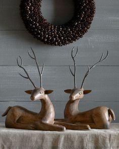 Two Wood Deer With Metal Antlers at Neiman Marcus.