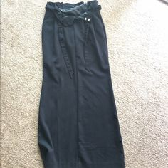 Black Maxi Skirt This black maxi skirt has never been worn! It has pockets as well as a tie around the waist. The tag says stretch on it but doesn't seem to have too much stretch to it. Definitely more of a formal skirt. Old Navy Skirts Maxi