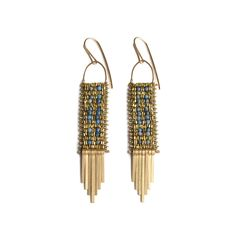 """Patterned earrings with faceted blue sodalite beads, antiqued brass beads in an intricate one of a kind pattern.  Brass tassel fringe and 14k gold fill ear wires.length: 3.25"""" width: .5"""""""