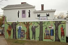 Westwood is a story of people. This mural highlights key neighborhood residents from different time periods with native trees dividing each: a Shawnee Native American, Phillip Longworth, James Gamble, and a teacher and two youth representing Westwood's value on education and the future of the neighborhood.