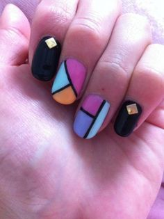Cute Nail Designs | Black Gel Nails with Retro Color Pattern and Gold Studs.