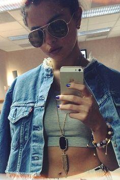Selena Gomez wearing Urban Renewal Cropped Denim Jacket, Kendra Scott Rayne Necklace, Nialaya Cz Diamond Amethyst Carnelian & Cherry Quartz Bracelet and American Apparel Baby Rib Crop T in Heather Grey.
