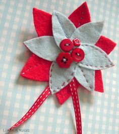 Red and blue felt flower corsage with button by Linen & Roses