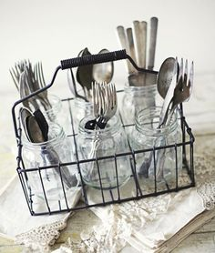 vintage milk bottle holder as cutlery holder