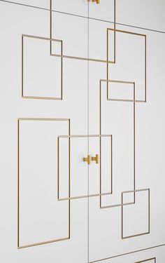 White wardrobe cabinets with geometric gold trim add a warm, glowing contrast along with gold leaf drawer hardware. Wardrobe Cabinets, Wardrobe Closet, Built In Wardrobe, Closet Doors, Wardrobe Laminate Design, Wardrobe Door Designs, Wardrobe Design Bedroom, Floor To Ceiling Wardrobes, Furniture Makeover