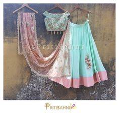 Offbeat Off Shoulder Welcome the summer in this cool mint green embroidered off shoulder blouse with tassel detailing paired with mint green color black lehenga and peach embroidered dupatta.For more information  Whatsapp on +91-9022617481. 11 April 2018