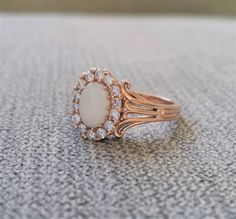 "Opal Diamond Engagement Ring Edwardian Victorian Filigree Art Nouvea Art Deco Setting 14K Gold ""The Trumpet"" by PenelliBelle on Etsy https://www.etsy.com/listing/487232872/opal-diamond-engagement-ring-edwardian"